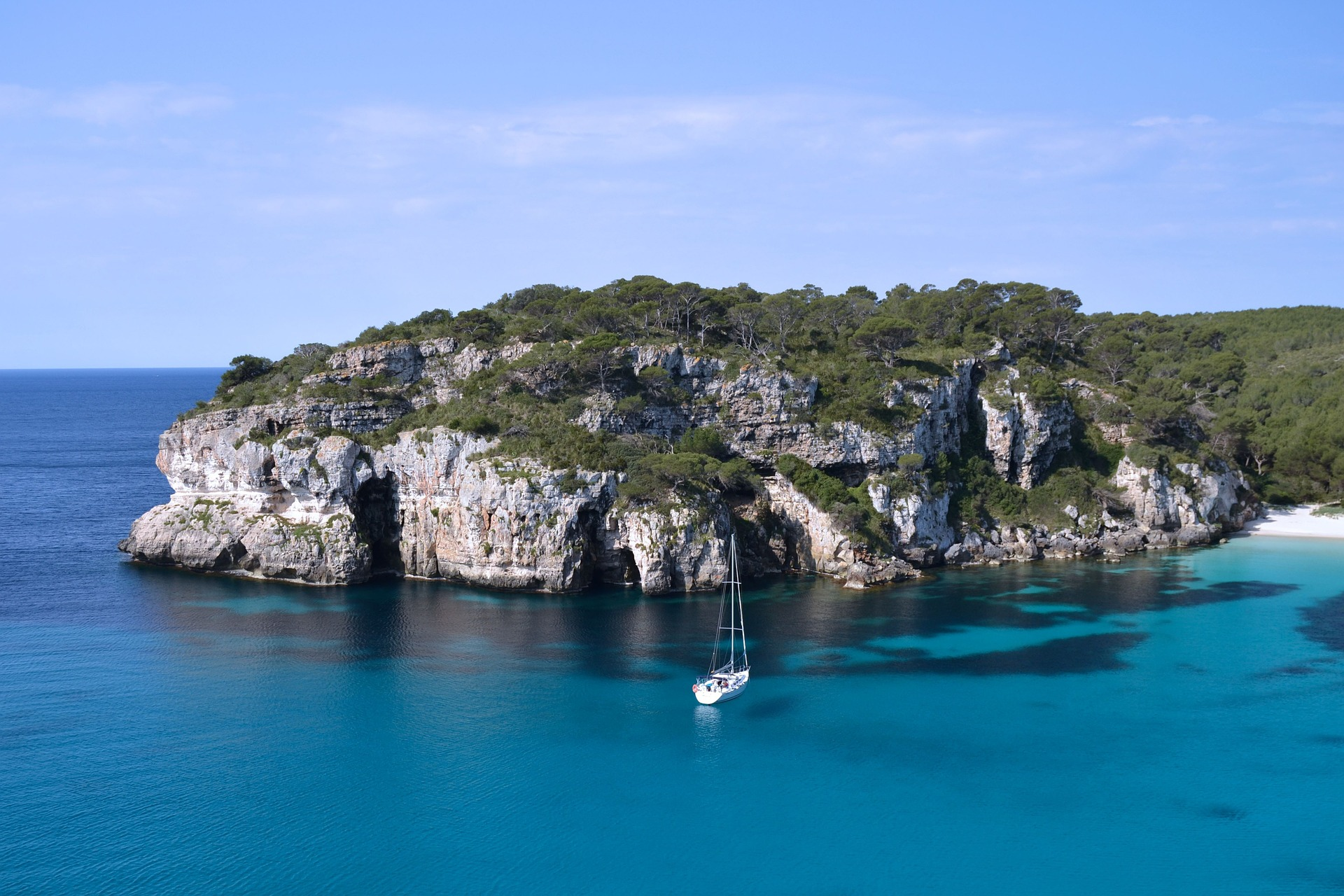 Formentera beach and cliffs, rent a boat in Spain