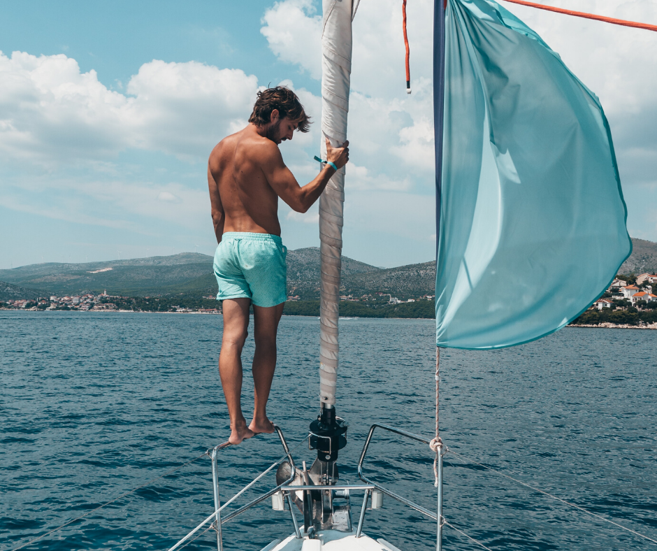 person sailing, man on a boat, how to rent a boat with Nautal, how to rent a boat
