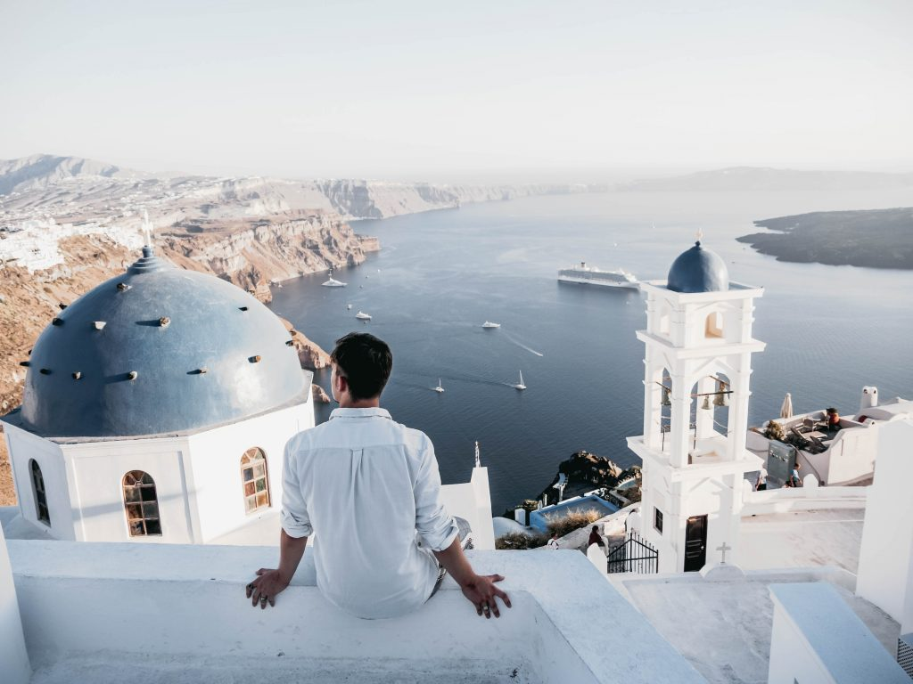 Man with relaxing views in Santorini