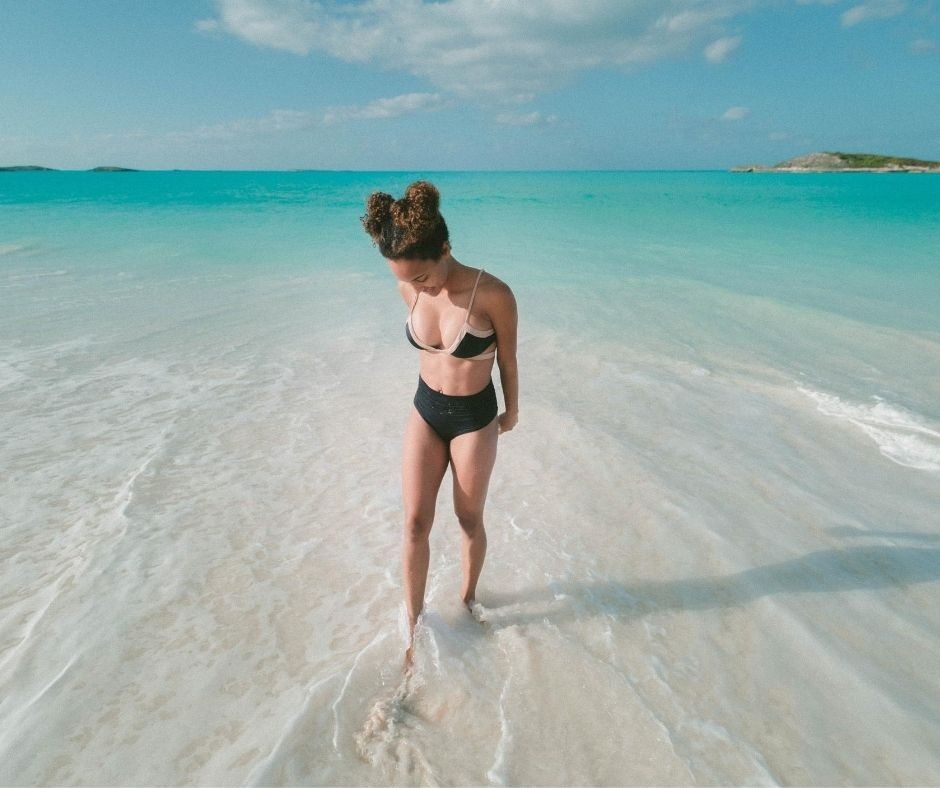 Girl in the clear waters of Bahamas