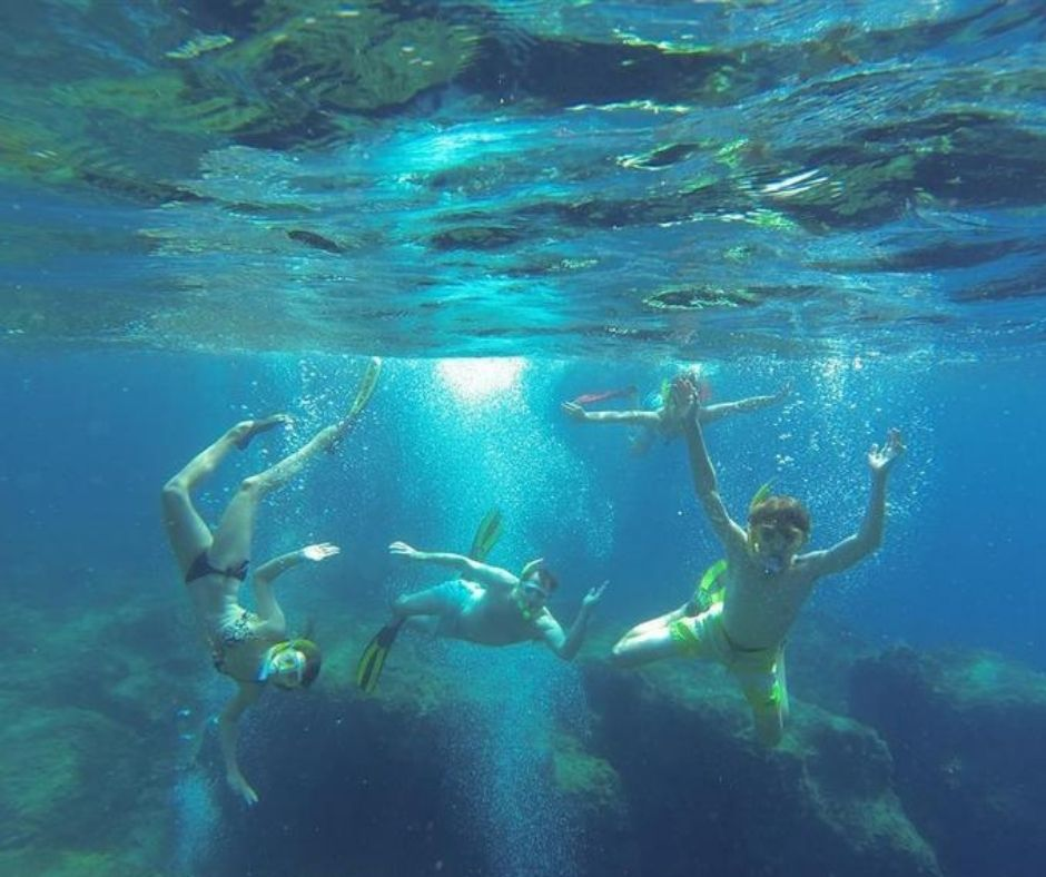 Family travelling together, snorkelling
