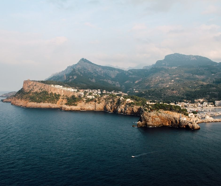 a beautiful view on Port of Sóller in Mallorca with mountains and the caves