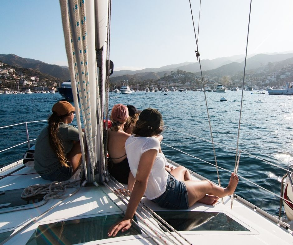 friends sitting on the yacht in Marbella and sailing to the bay