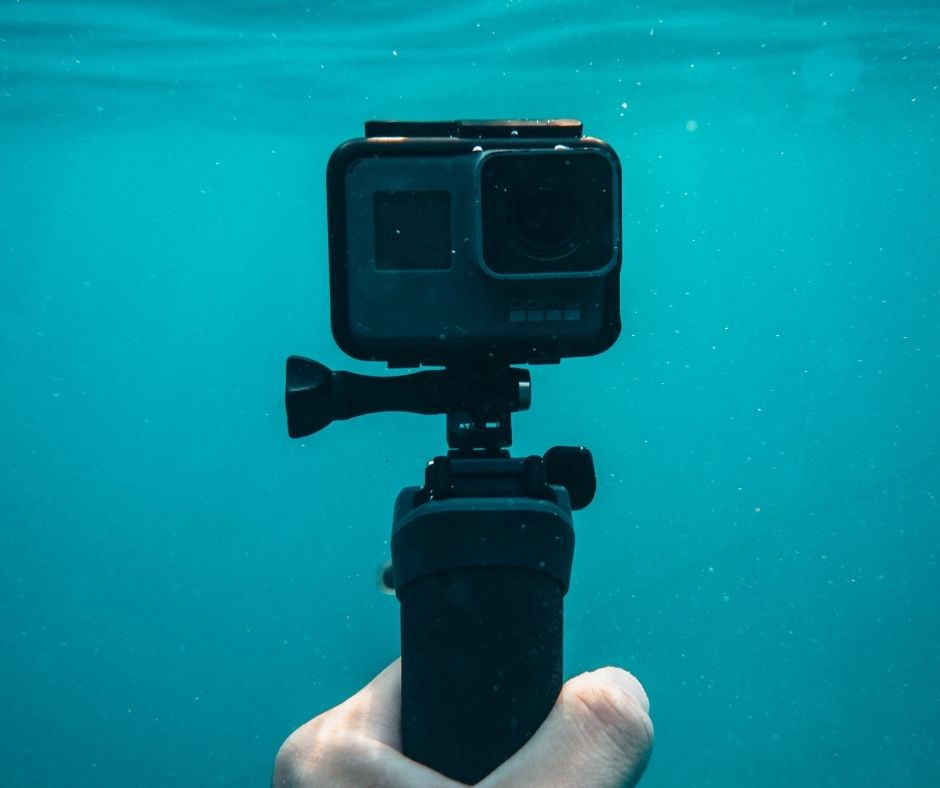 a sports camera in the water for a sailor