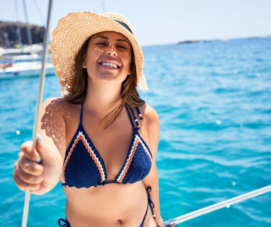 girl smiling on a boat