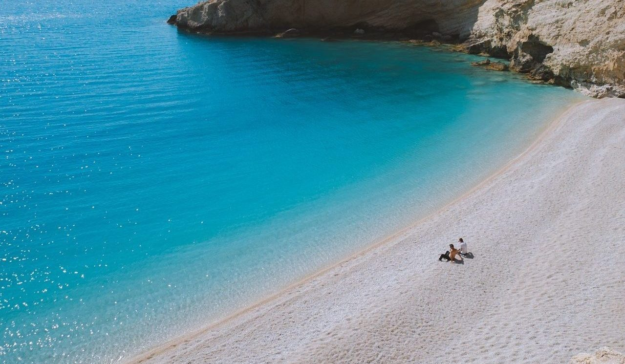 beach in Greece, sea, ocean, blue water, people relaxing,