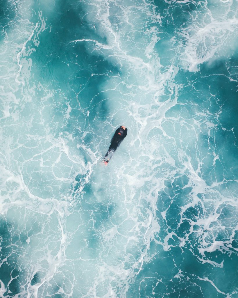 person swimming in the water. Ocean, waves. Things to do in boating trips