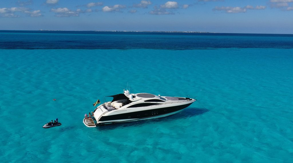 boat in blue water, turquoise water, boat in water, jet ski, adventure in the water