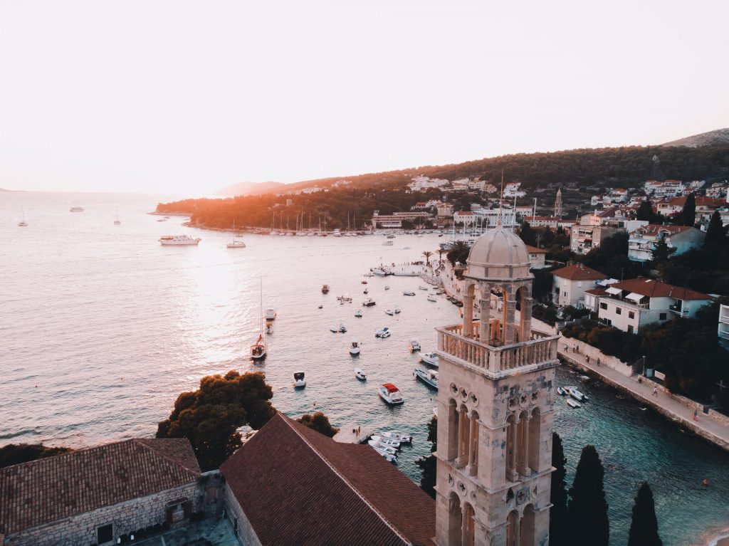 church, view of hvar town, hvar church, boats in hvar bay, sunset, blue water, small bay,