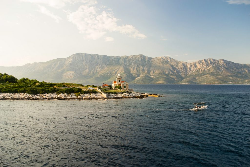 mountains, church, boat, croatia island, croatian mountains, hvar croatia, rocky beach, adriatic sea, boat sailing through adriatic sea,