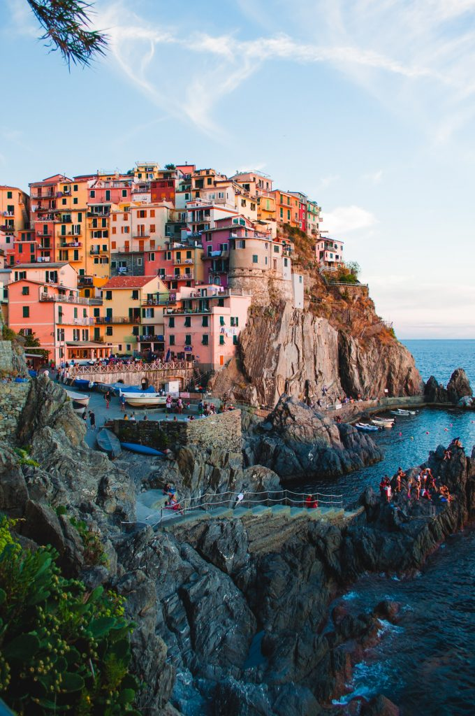 Manarola Italy, Italy, Manarola, Cinque Terre, Cinque Terre Italy, cliffs, colourful houses, houses on a cliff, boats, water, village on the water, best places to visit in italy