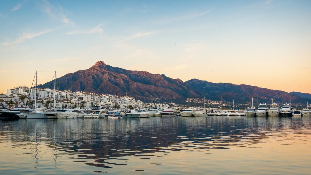 Marbella, Spain Marbella beaches, marbella mountains with boats in the front, beautiful beach view